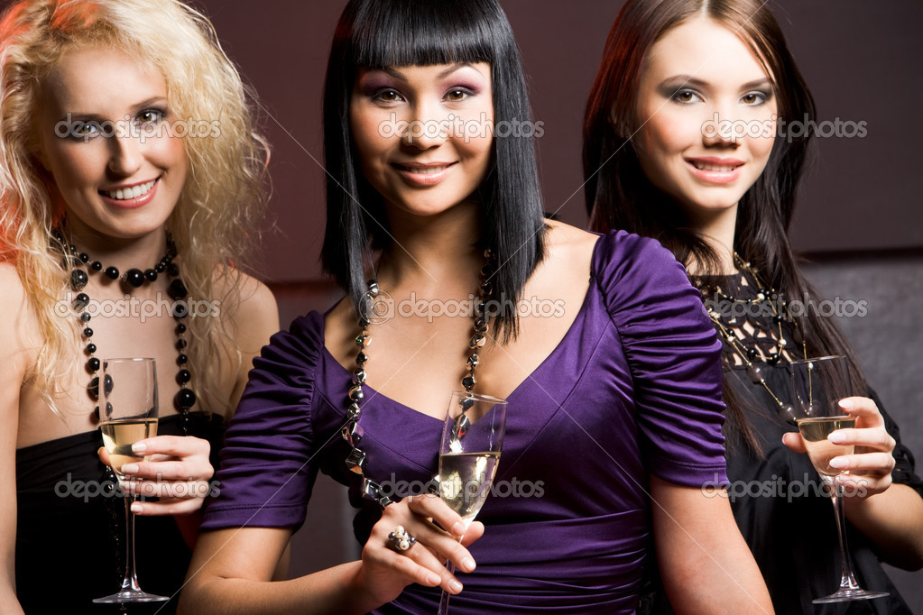 Portrait of three fashionable pretty women looking at camera with smiles — Stock Photo #10730279