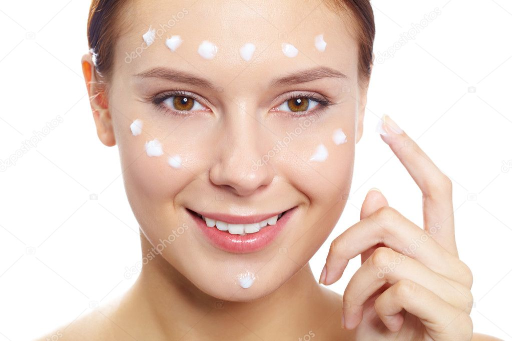 Fresh woman applying hydrating cream onto her face — Stock Photo #10730633