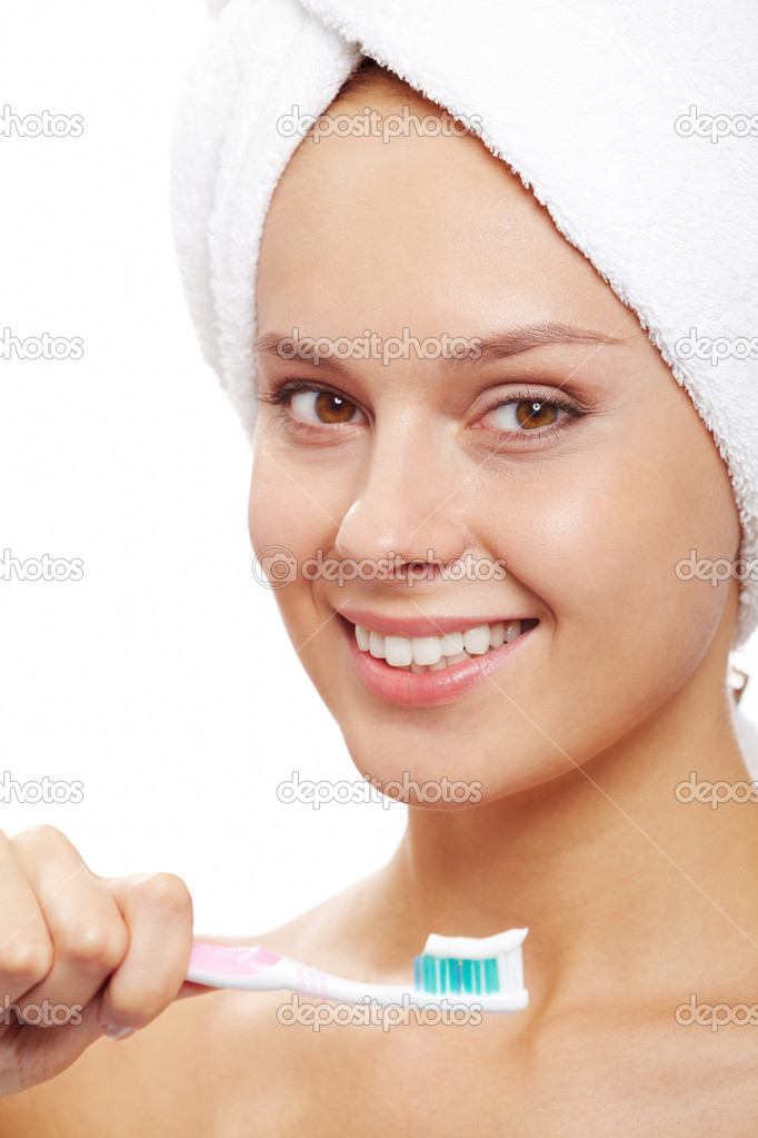 Happy woman with toothbrush looking at camera  Stock Photo #10730642