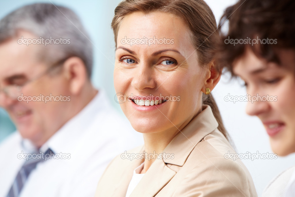 Smiling business woman looking directly at camera — Stock Photo #10730783