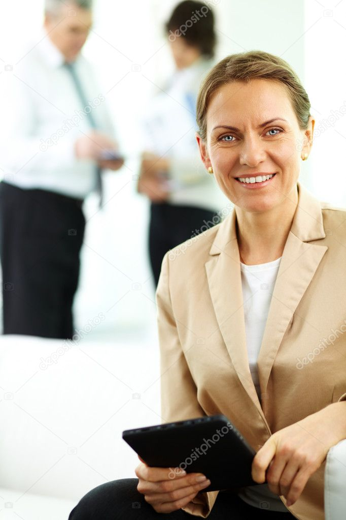 Smiling business woman looking at camera in working environment — Stock Photo #10730849