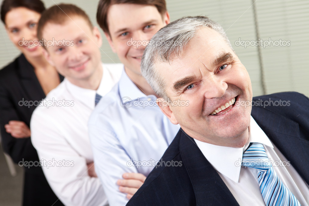 Image of a happy senior chief and his team — Stock Photo #10730961