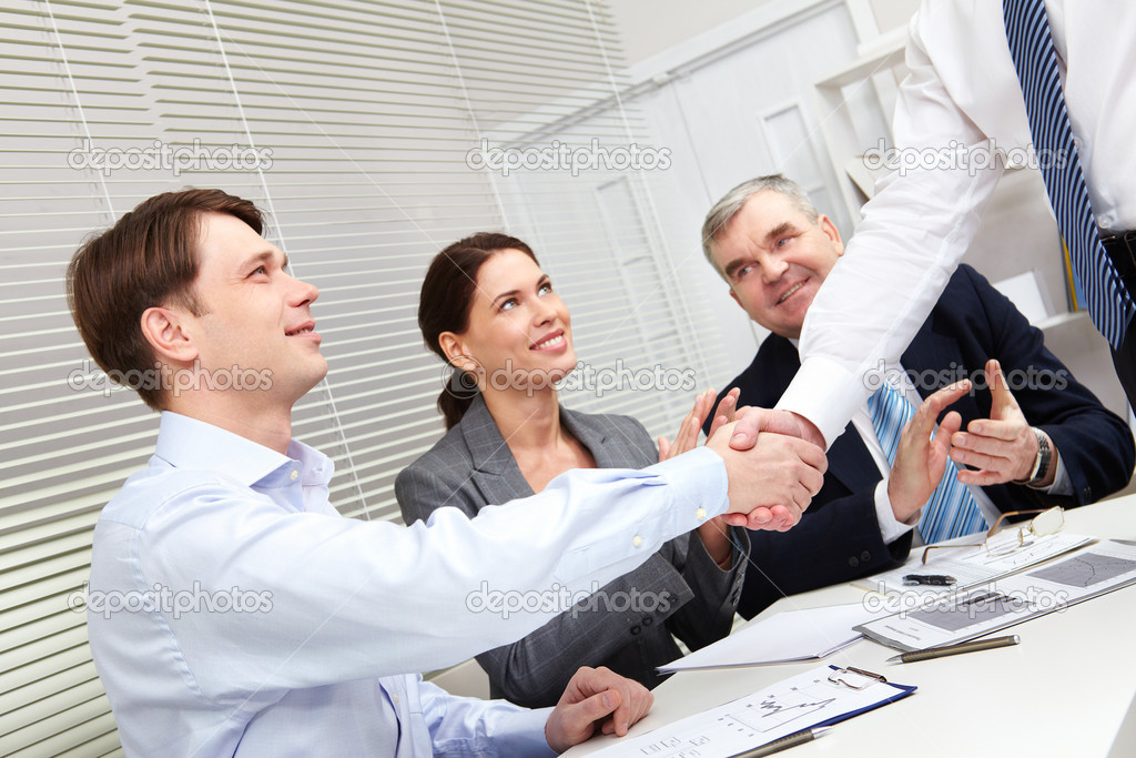 Tilt-up of business giving a handshake to conclude the deal — Stock Photo #10730963