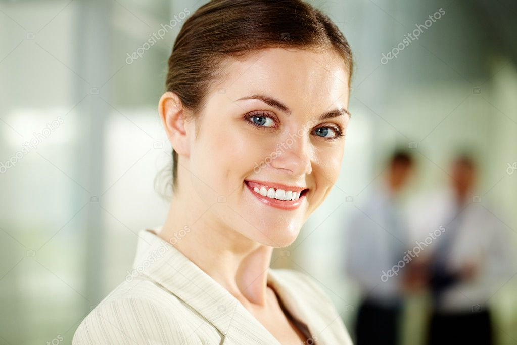 Smiling businesswoman looking at camera with smile — Stock Photo #10731705