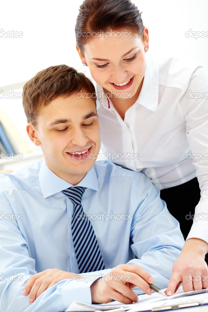 Businessman and his colleague looking at working plan at meeting — Stock Photo #10731903