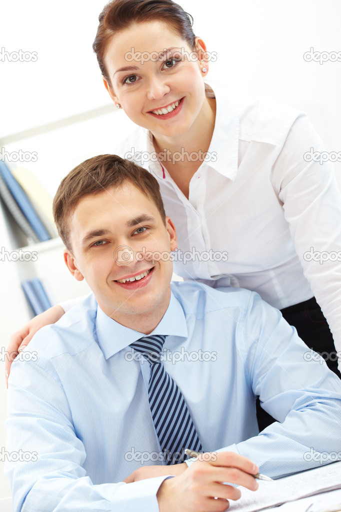 Portrait of happy leaders looking at camera with smiles  Stock Photo #10731905