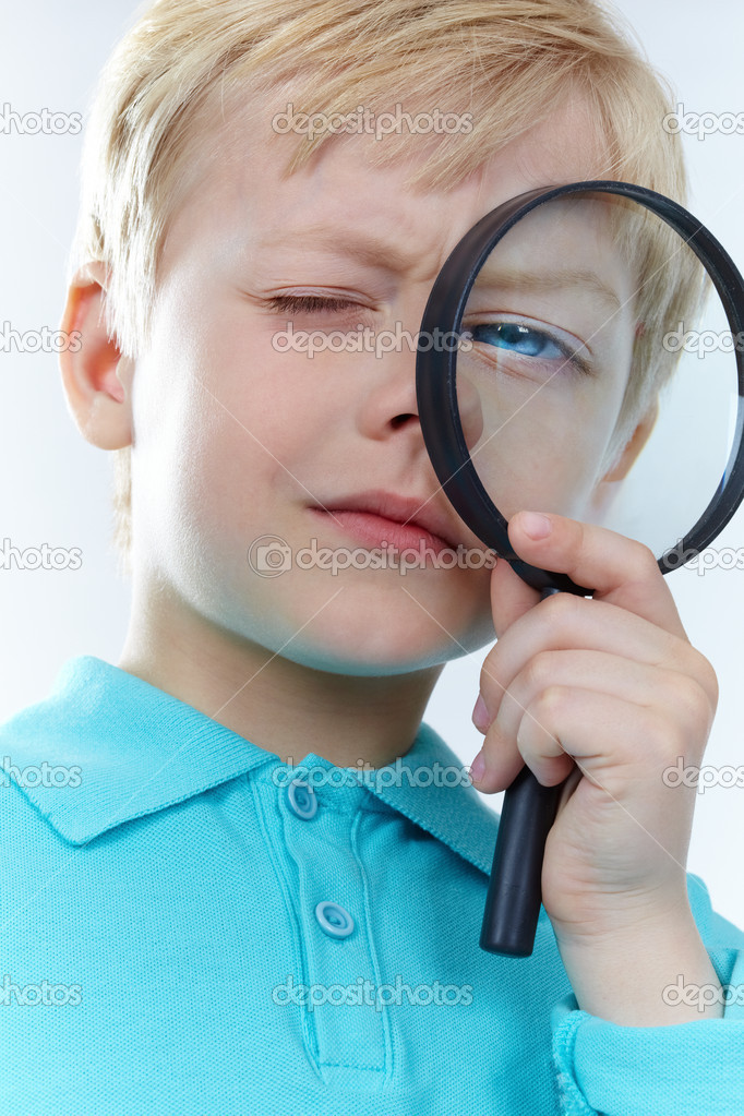 Portrait of a kid looking through magnifying glass — Stock Photo #10732365