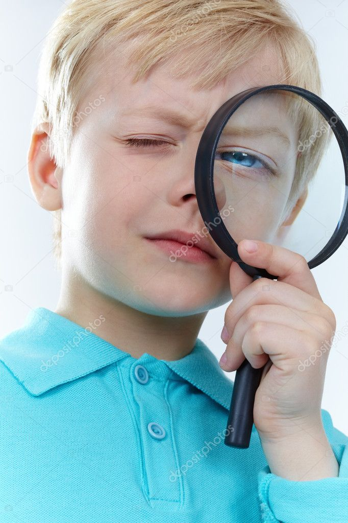 Portrait of a kid looking through magnifying glass    #10732365