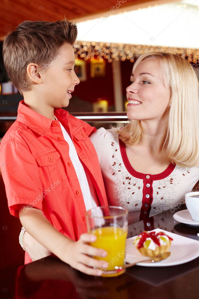 Mother and son spending time together at a cosy cafe  Stock Photo #10733316