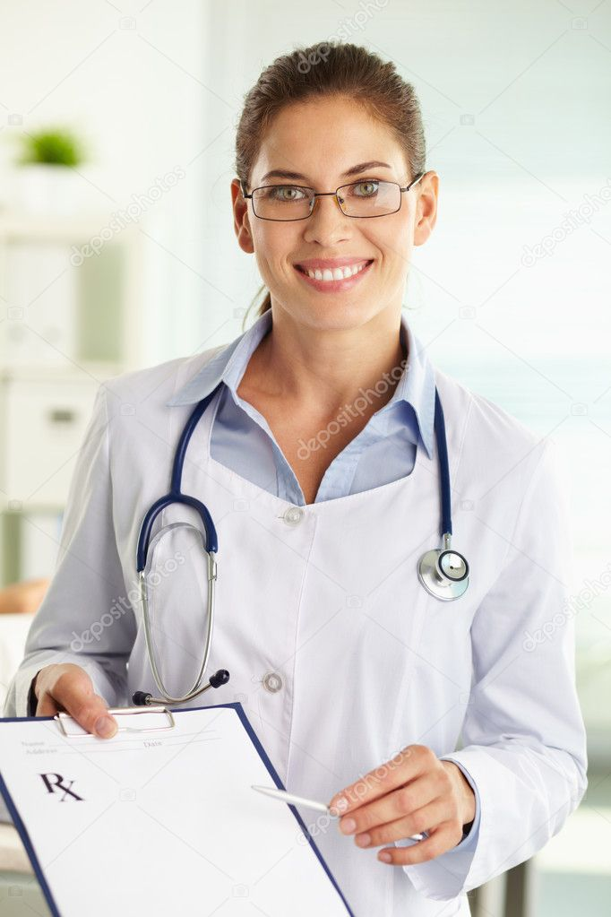 Portrait of a female doctor smiling cheerfully at camera — Stock Photo #10733838