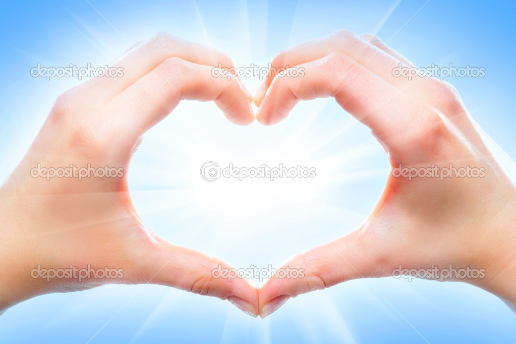 Human hands forming a heart shape  Stock Photo #10733913