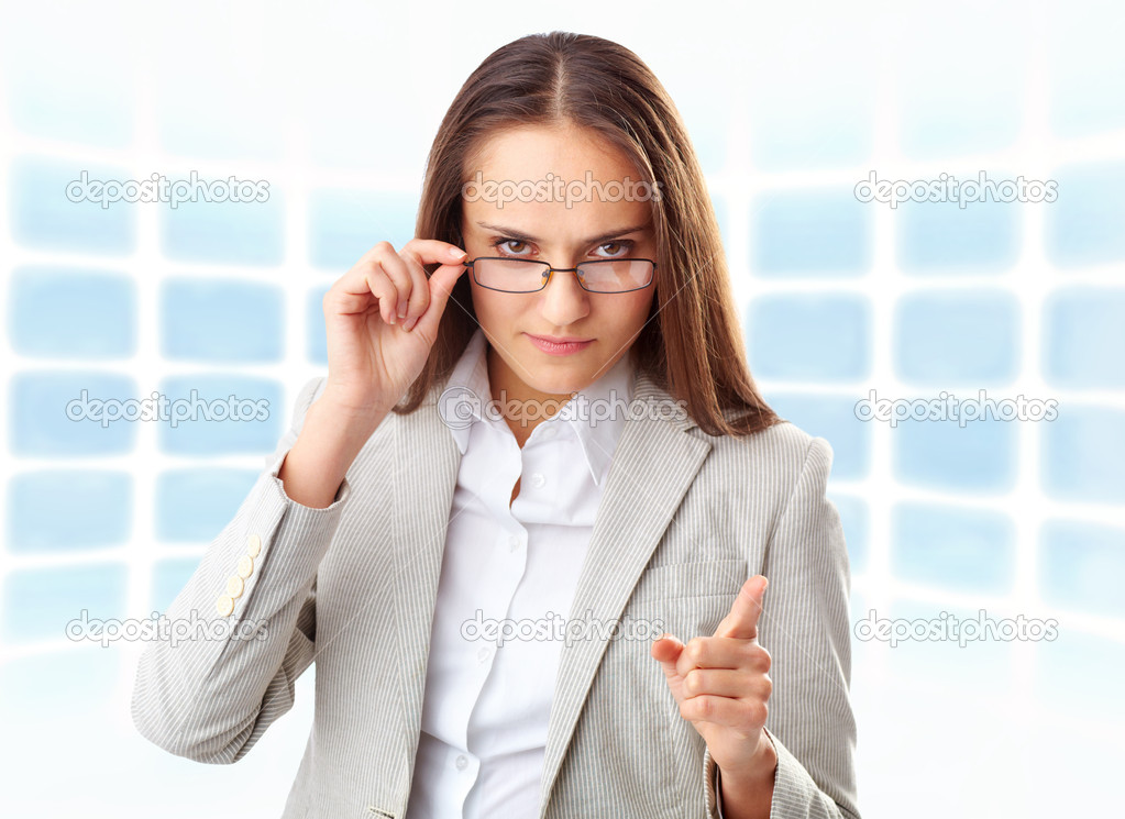 Creative image of strict businesswoman looking at camera — Stock Photo #10734166