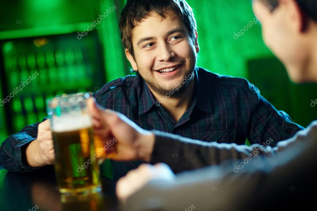 Two guys hanging out in bar with mugs of beer — Stock Photo #10734186