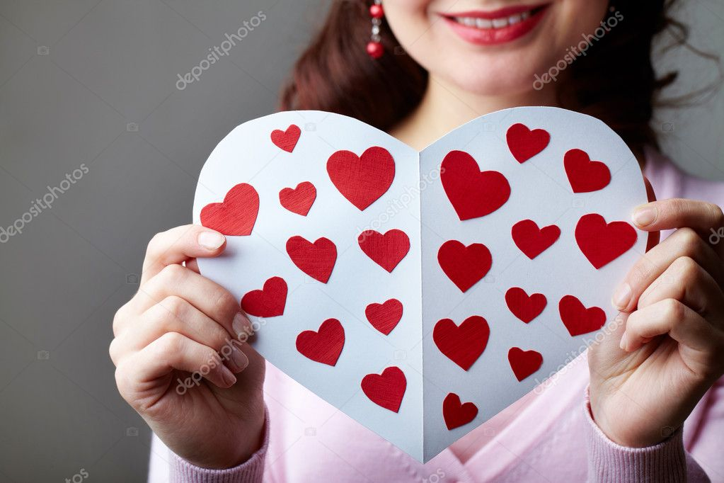 Close-up of female hands holding valentine card — Stock Photo #10734807
