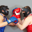 Fighting in helmets - Stock Photo