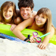 Stock Photo: Friends with swimwear