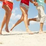 Running on sand — Stock Photo