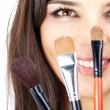 Face behind brushes — Stock Photo