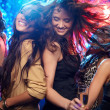 Young women having fun dancing at nightclub — Stock Photo #10745847