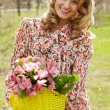 Female with flowers — Stock Photo