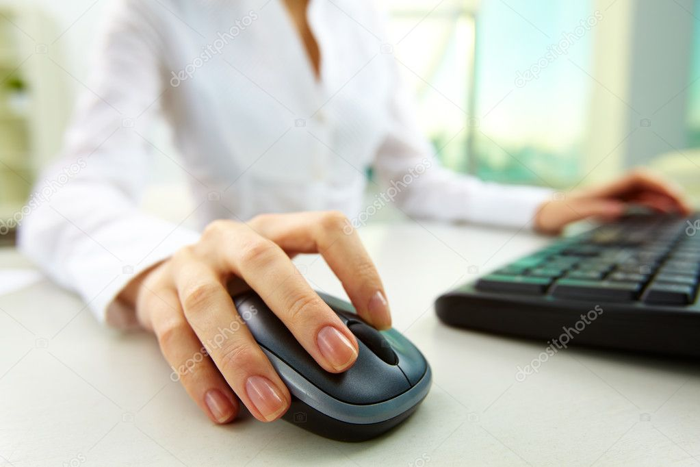 Image of female hands pushing keys of a computer mouse and keyboard — Stock Photo #10745994