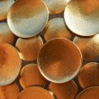 Stock Photo: Background of golden discs. architectural detail.