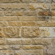 Stock Photo: Frontal view of sandstone wall