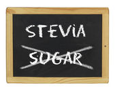 Chalkboard with stevia and sugar written on it — Stock Photo