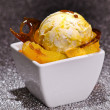 Ice cream on caramelized sugar and oranges — Stock Photo