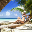 Beautiful shapely woman on tropical beach — Stock Photo