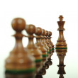 Chess king and pawns — Stock Photo