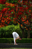 A young woman doing yoga exercise outdoors — Stock Photo