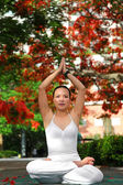 A beautiful Asian woman exercising yoga — Foto Stock