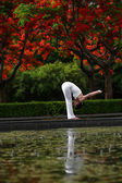 Yoga with reflection in water — Stock Photo