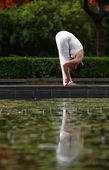 Yoga forward bend — Stock Photo