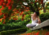 Yoga under flame-tree — Stock Photo