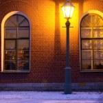 Lamp and brick wall — Stock Photo
