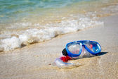 Mask and snorkel lying on sand — Stock Photo
