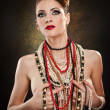Stock Photo: Young beautiful womwith beads and jewelry