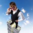 thumbnail of Young businessman with money symbols