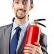 thumbnail of Man with fire extinguisher in firefighting concept