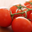 thumbnail of Fresh tomatoes on wooden surface