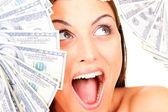 Mladá šťastná žena s dolarem