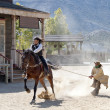 Постер, плакат: Sheriff dragging a Bandit by rope from his horse