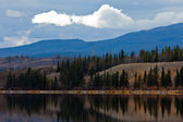Power Line at Calm Yukon Lake in Late Fall, Canada