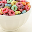 Постер, плакат: Kids delicious and nutritious cereal loops or fruit cereal