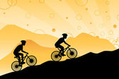 A vector illustration of a group of silhouette mountain bikers