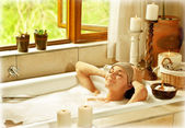 Woman taking bath