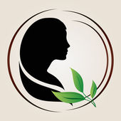 Illustration of female profile silhouette with green leaves near it