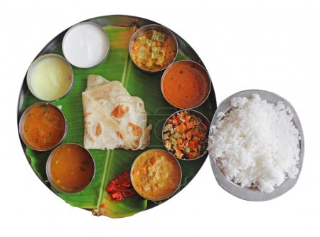Постер, плакат: South indian plate meals on banana leaf on white, холст на подрамнике